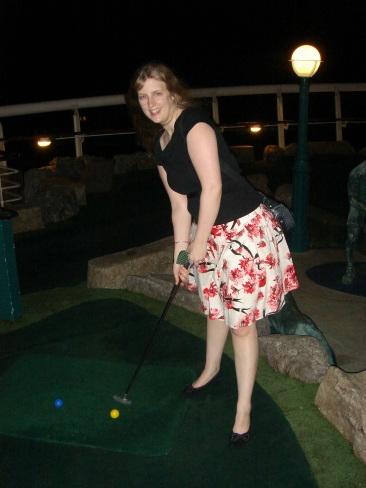 Voyager of the Seas - Joanne playing golf at night