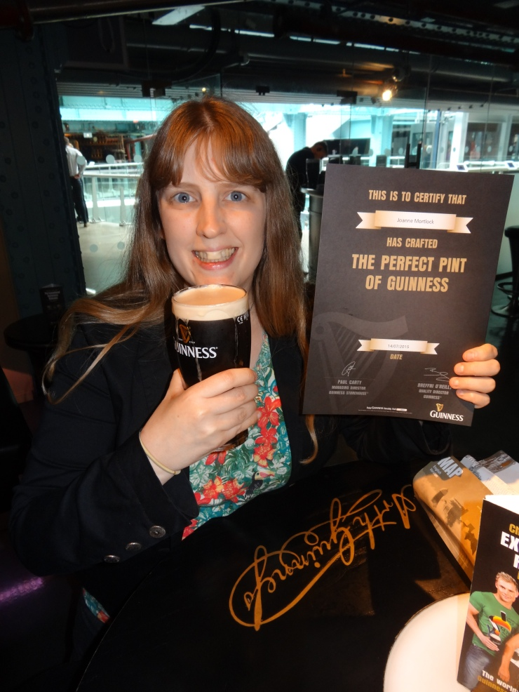 Dublin - July 2015 - Guinness Factory - Joanne and her certificate for pouring perfect pint