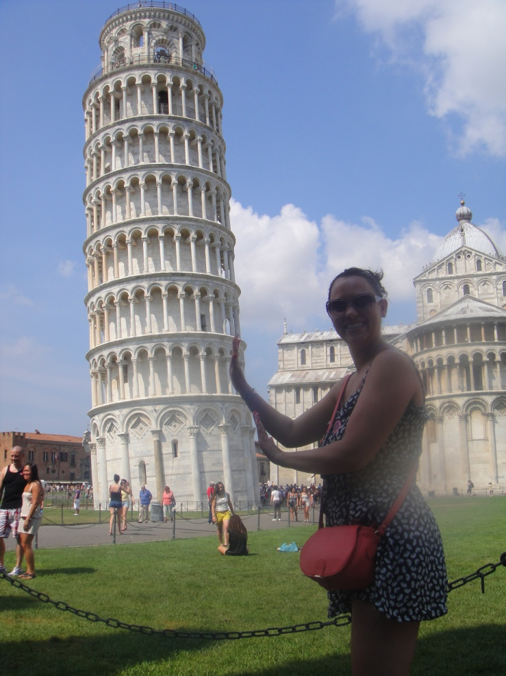 Livorno - July 2012 - Emma pushing The Leaning Tower of Pisa