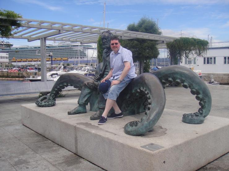 Vigo - July 2012 - Jason with the man on a octopus statue