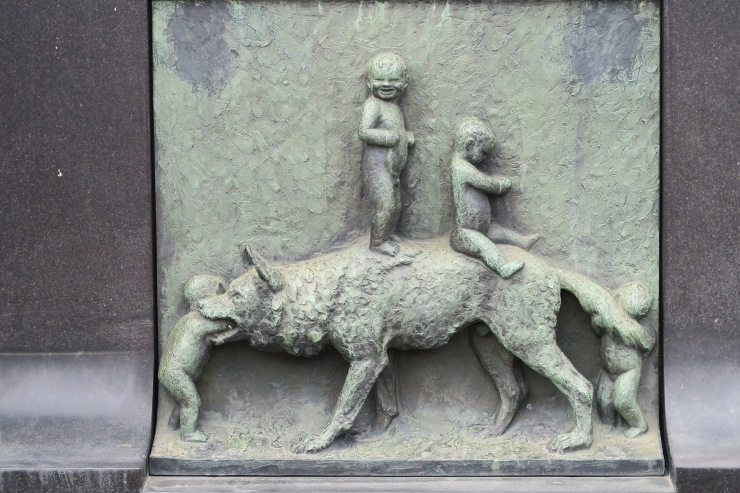 Oslo - June 2017 - The Vigeland Park fountain of tree of life plaques wolf and kids